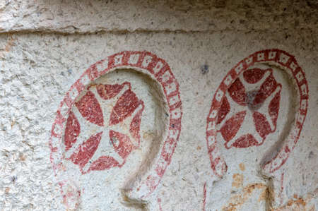 Close up of ancient drawings in Goreme, Cappadocia, Turkey