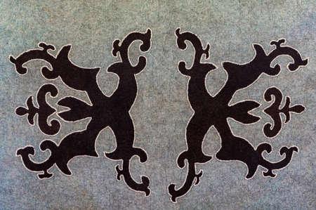 National Balkar pattern made with black thread on gray woolen fabric Stok Fotoğraf
