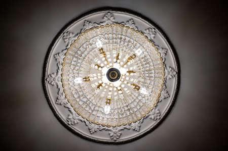 Bottom view photo of round classic designer chandelier
