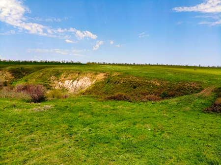 Landskape drone view on green ravine in spring sunny day at steppe Foto de archivo