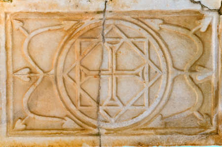 Ruined marble bas-relief with Christian symbols in Hierapolis Turkey