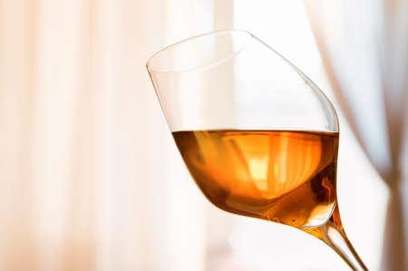 Close up of white port wine in wineglass Foto de archivo