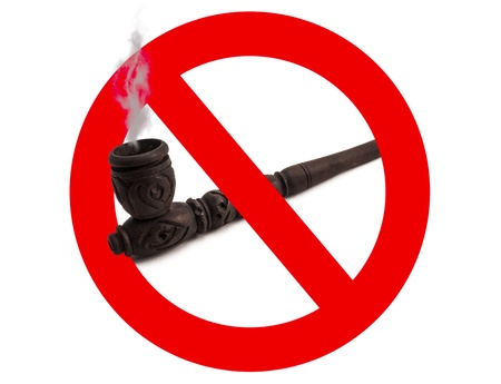 disallow: Wooden carved smoking pipe  with prohibitory sign on white background Stock Photo
