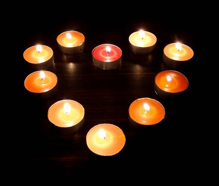 no fires: Heart candles on a dark background