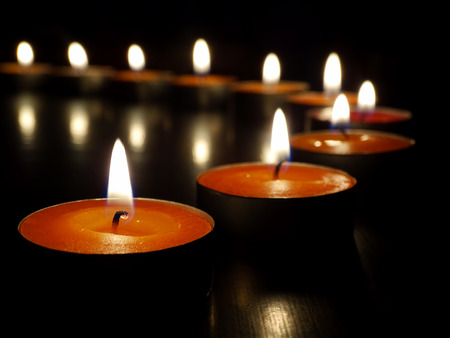 votive candle: candles on a dark background