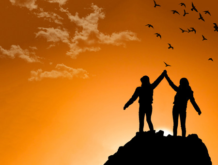 raised viewpoint: friends on Top of a Mountain Shaking Raised Hands