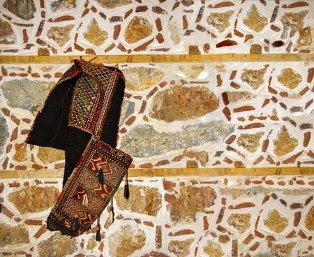 saddlebag: Old stone wall and saddlebag Stock Photo
