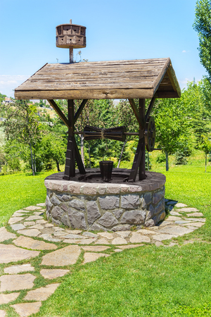 Old artesian Water Well With Pulley and Bucket Stok Fotoğraf