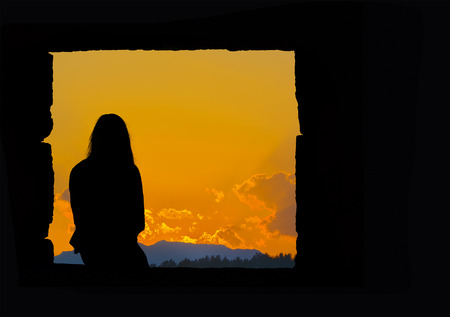 lonely girl silhouette sitting at sunset