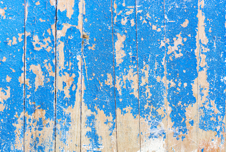 old board with peeling paint blue