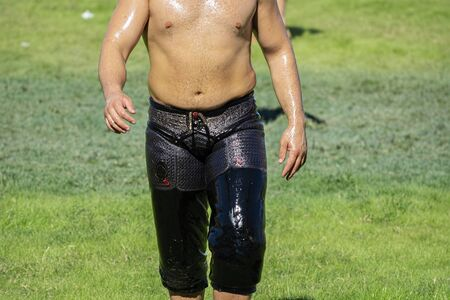 oily wrestling, wrestler on green grass Stock Photo