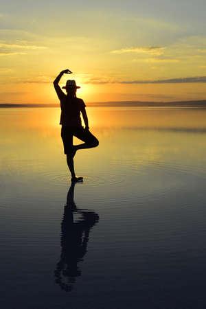 sunset meditation and reflection. Sunset, Salt Lake Aksaray, Turkey.
