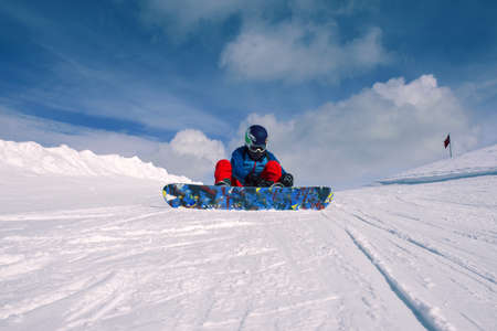 Girl snowboarding in the mountains on the snowboard. Reklamní fotografie