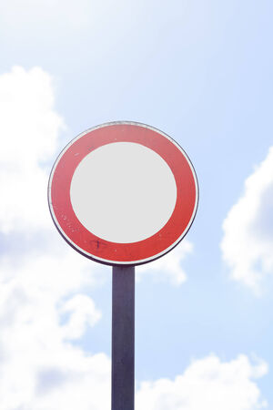 round road sign with white area and sky in the background photo