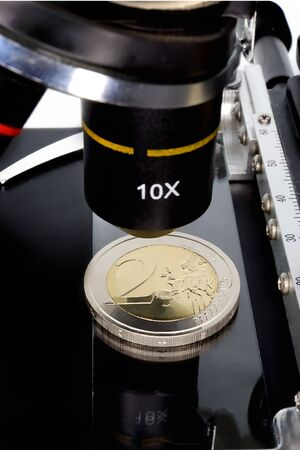 funding of science: Euro currency in check under the microscope. Stock Photo