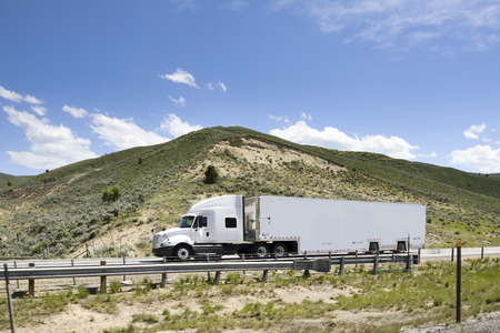 Shot of a big trucks traveling along the highway of the america. Foto de archivo