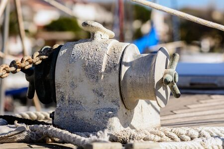 windlass: Fragmentary view details of knots and ropes on the yacht moored in the dock. Anchor Windlass Yacht