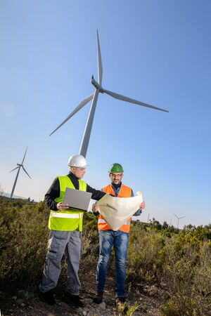 conservation: Engineers of wind turbine control projects and production. Stock Photo