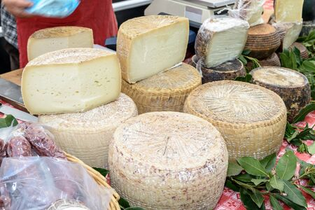 Pecorino cheese typical processing of Sardinia exposed for sale.