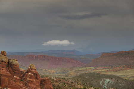 canyonland: Landscape Moab desert with gray clouds on the horizon. UTAH, USA. Stock Photo