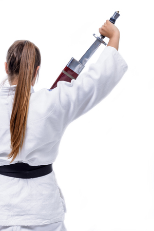 image created 21st century: Young athlete hand, martial arts, hold a sword. Stock Photo
