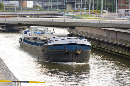 River cargo ship goes from canal