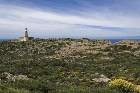 Capo Sandalo Lighthouse on the Westernmost point os St Pietro Island. Southwestern corner of Sardinia, Italy