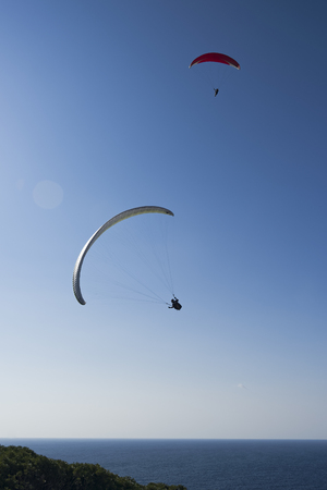 Paragliders in the blue sky.