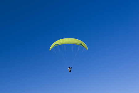 Paragliding sport in blue sky.