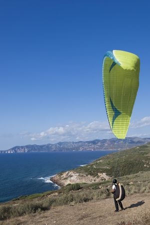 Departure with paragliding along the coasts of southern Sardinia.