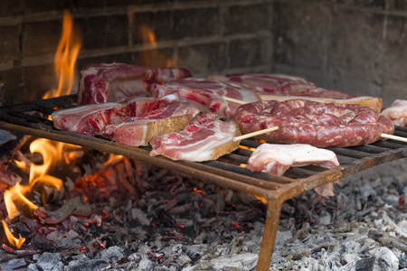 Flames Grilling a Steak on the BBQ. Grill Beef Steak Barbeque.  Archivio Fotografico