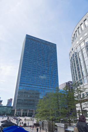 London, United Kingdom - August 13, 2017: The headquarters of JP Morgan at Canary Wharf in the financial heart of London pictured against a clear blue sky