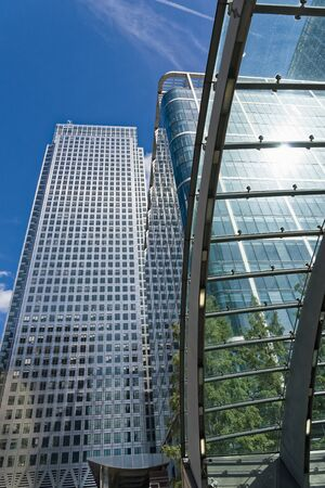 window view: London, England - August 13, 2017: Canary Wharf underground station Docklands London UK. Modern Architecture with glass and steel arch leading into the station.