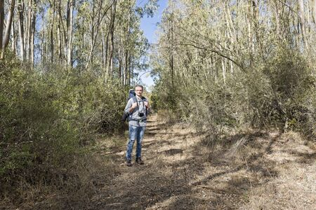 Hiker in the Sardinian of eucalyptus Forest with mirrorless camera Archivio Fotografico