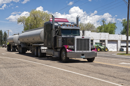Utah, USA - June 02, 2015:Truck with tanker trailer crosses a North American country. Camion on road. Utah, USA June 02, 2015 Reklamní fotografie - 93494341