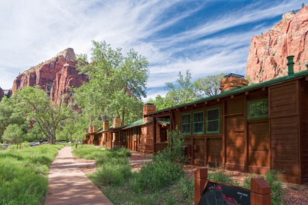 Springdale, Utah, USA - June 3, 2015: Zion Lodge at Zion National Park near Springdale, Utah. Tourists stop and rest at Zion Lodge. Zion Lodge is the only accommodation in a park and is nestled deep in Zion Canyon with a gift and souvenir shop and easy ac