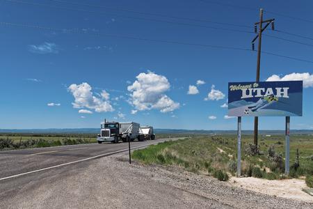 Utah, United States - June 02, 2015: Peterbilt truck with double cistern crosses the border of Utah. Peterbilt trucks cross the States for thousands of miles.. Peterbilt trucks cross the States for thousands of miles. The Denton Texas USA based Peterbilt