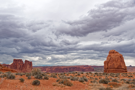 Landscape a look on the rocks of the Arches National Park. Its home to over 2,000 natural sandstone arches. In addition to a variety of unique geological resources and formations. Stock Photo