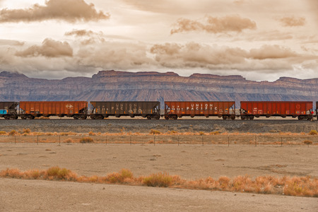 Moab, Utah, USA - June 6, 2015: Rusted cars stationed on the tracks. The Union Pacific Railroad is an American freight railroad company headquartered in Omaha, NE.