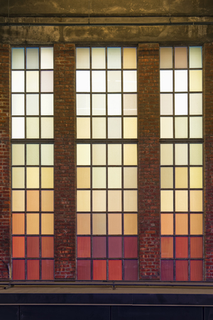 Old colored windows with warm shades. Red, orange, yellow squares.