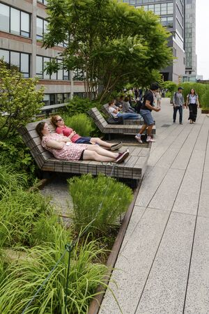 New York, NY, USA - June 8, 2015: The High Line Park in New York City, USA. It is a 2,33 km long elevated linear park, greenway and rail trail, created on a former New York Central Railroad spur on the west side of Manhattan. Editorial