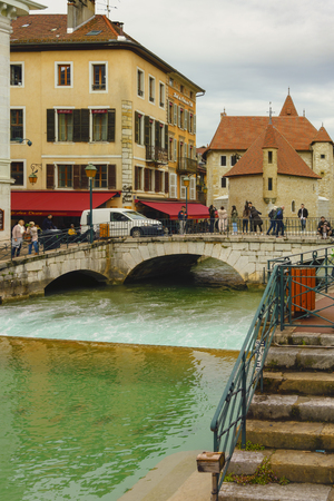 Annecy, France - May 01, 2018: Medieval old town and the tower of Palais de l'Isle castle on Thiou river in Annecy, Savoy, France Archivio Fotografico - 105180237