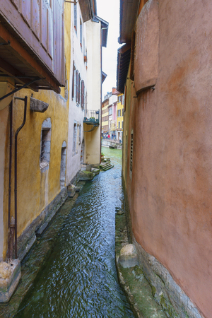 Annecy, France - May 01, 2018: Medieval old town and the tower of Palais de l'Isle castle on Thiou river in Annecy, Savoy, France Archivio Fotografico - 105180240