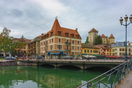 Annecy, France - May 01, 2018: Medieval old town and the tower of Palais de l'Isle castle on Thiou river in Annecy, Savoy, France Archivio Fotografico - 105180241