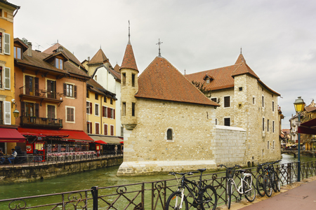 Annecy, France - May 01, 2018: Medieval old town and the tower of Palais de l'Isle castle on Thiou river in Annecy, Savoy, France Archivio Fotografico - 105180242
