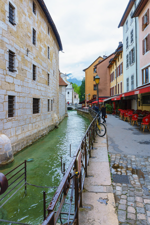 Annecy, France - May 01, 2018: Medieval old town and the tower of Palais de l'Isle castle on Thiou river in Annecy, Savoy, France Archivio Fotografico - 105180243
