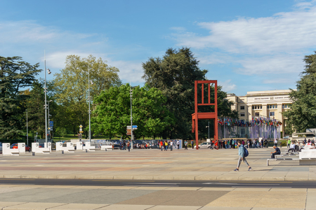 Geneva, Switzerland - April 04,2018: The Place of Nations,  gigantic Broken Chair, symbol of the fight against landmines at May 10, 2013 in Geneva, Switzerland. Around are the headquarters of about