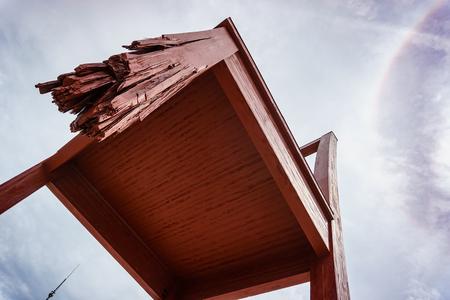 Geneva, Switzerland - April 04,2018: The Place of Nations,  gigantic 'Broken Chair', symbol of the fight against landmines at May 10, 2013 in Geneva, Switzerland. Around are the headquarters of about 250 international organizations. Artist Daniel Berset. Archivio Fotografico - 105180283