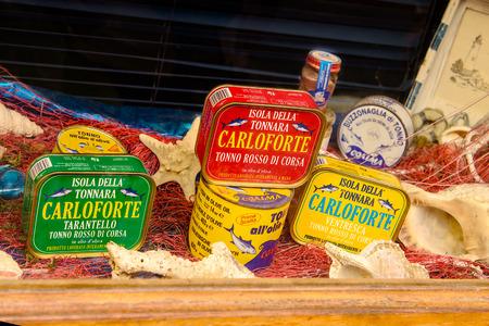 Carloforte, Sardinia, Italy - May 08, 2014: Typical canned tuna products on the island of San Pietro in Sardinia, Italy.
