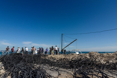 Fishermen lay down the nets and prepare for the departure at sea. Archivio Fotografico - 105180633